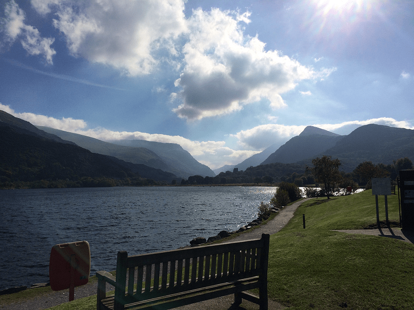 A view of Padarn Lake on a sunny day. Beautiful blue skies with Snowdon in the distance