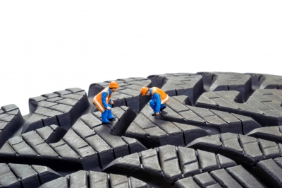 Little men checking tyre treads