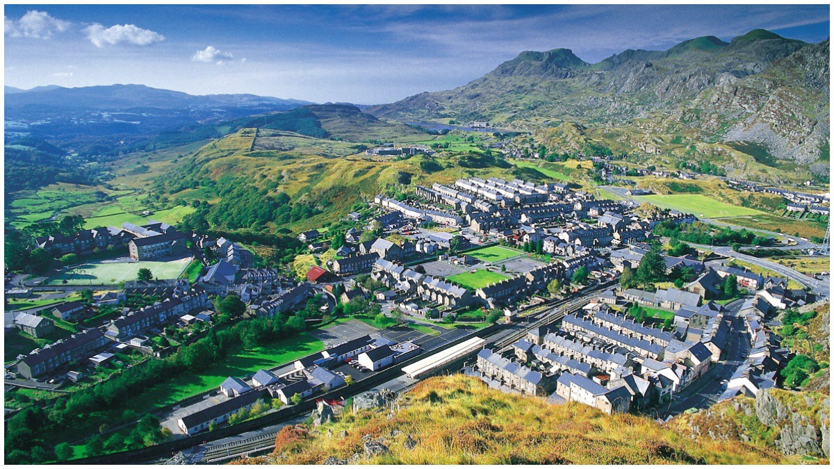 Photo of Blaenau Ffestiniog taken on a sunny day. View of the Moelwyns in the background. Taken by Dave Newbould