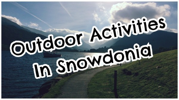 """The words """"outdoor activities in Snowdonia"""" in big bold print over a photo of Llanberis lake on a sunny day"""