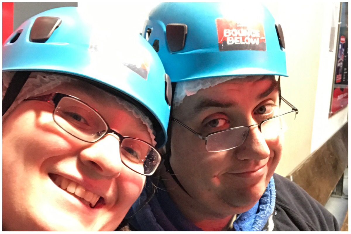 The husband and I wearing our hard hats as we prepare to go trampolining (underground!) at Bounce Below, Zipworld, Blaenau Ffestiniog