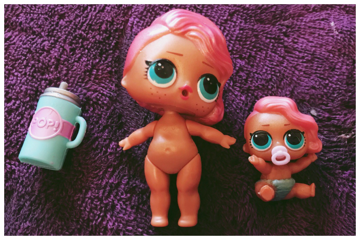 LOL Surprise Pearl Surprise Dolls - one big sister and one little sister sitting with their sippy cup
