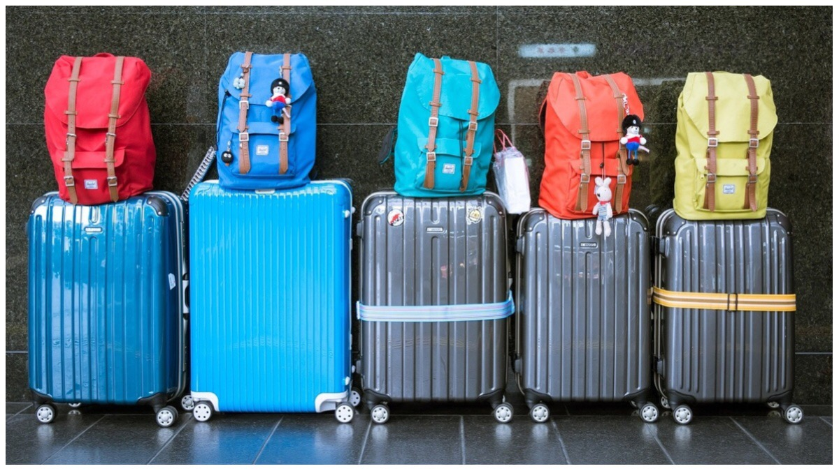 Set of five different suitcases and backpacks