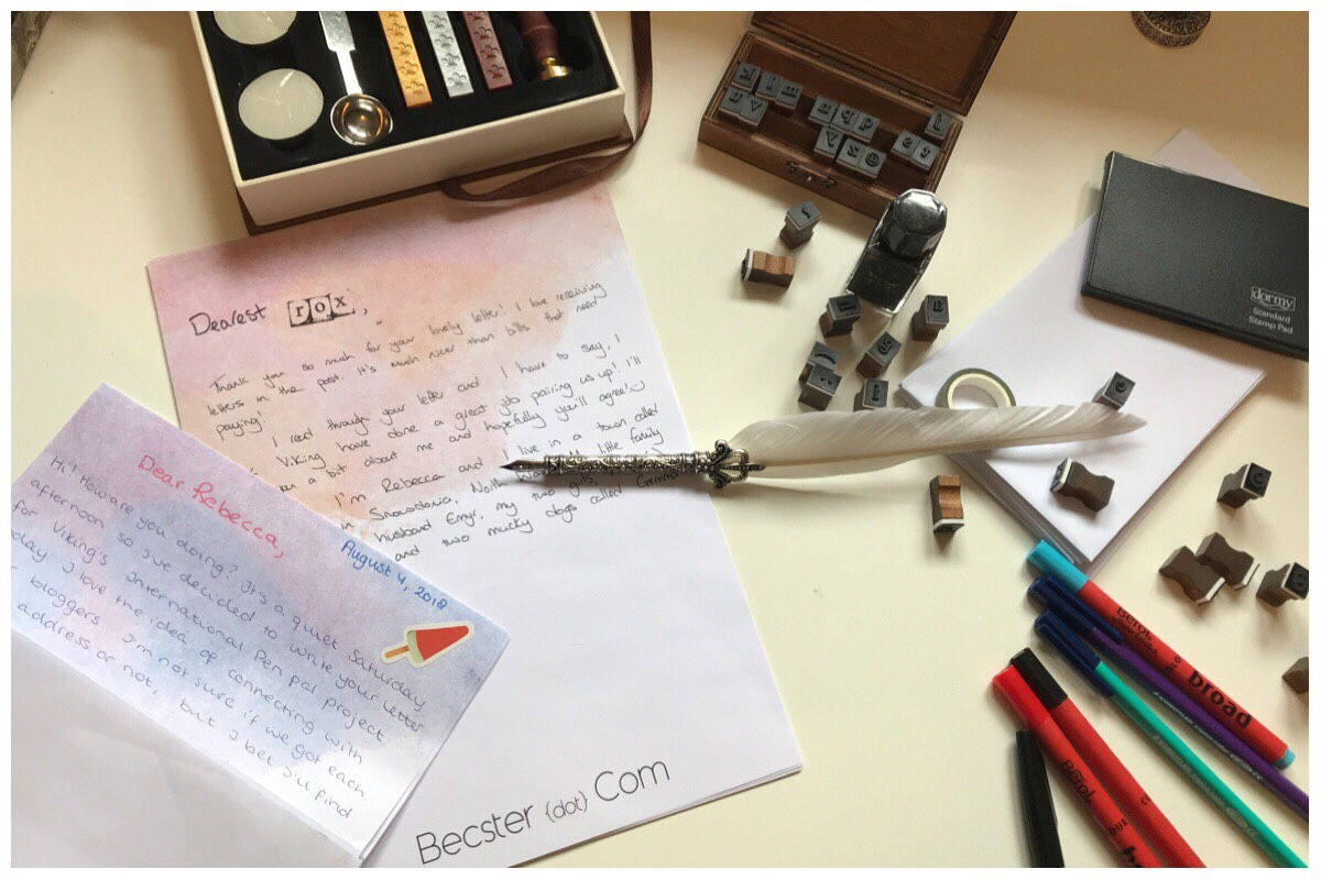 Flatlay photo of all the goodies received from Viking including the various pens and personalised paper. There's a half written letter on the desk