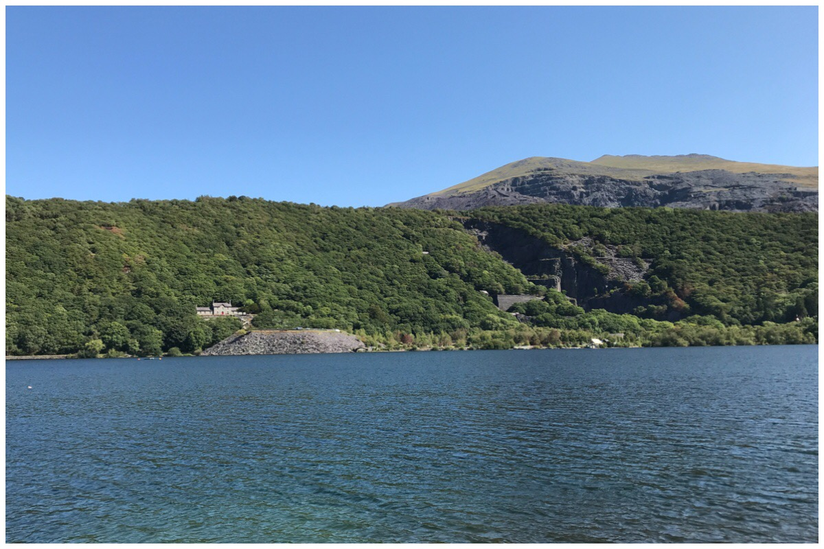 Llyn Padarn, Llanberis with the Quarry hospital and Vivian Quarry in the background