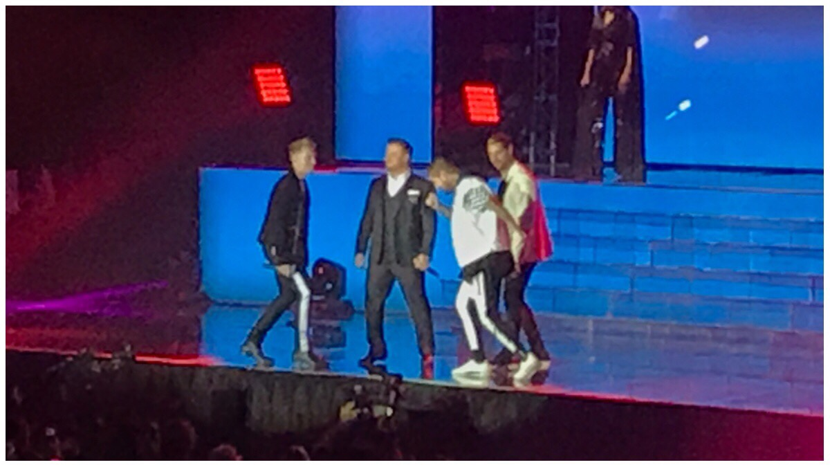 A rather blurry photo of Boyzone on stage - from left to right you have Ronan Keating, Mikey Graham, Shane Lynch and Keith Duffy