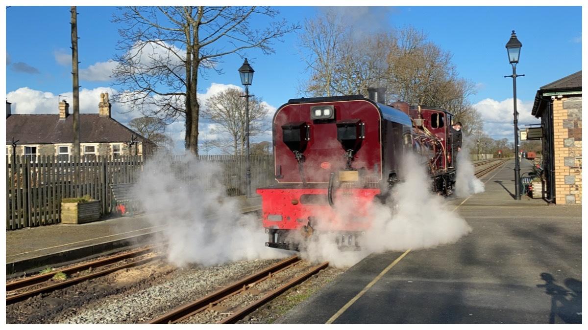 Ffestiniog & Welsh Highland Railways red Garratt 130 steaming at Dinas Station