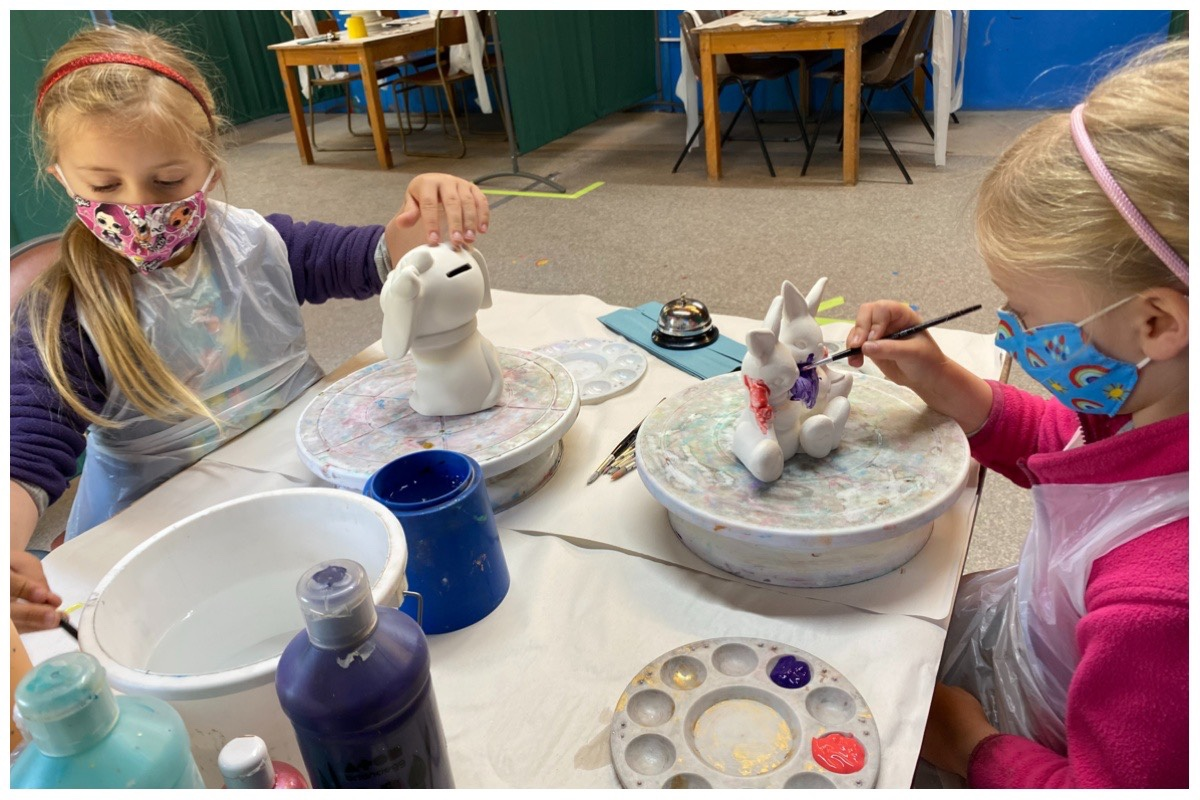 The girls painting at Piggery Pottery