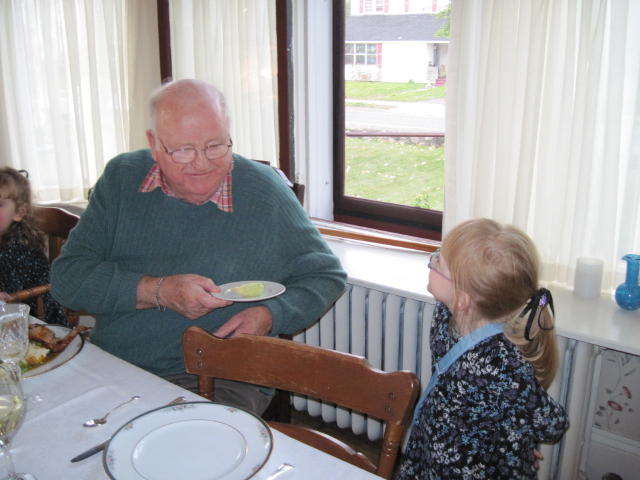 Sarah, presenting Grandpa with the corn she grew for him.