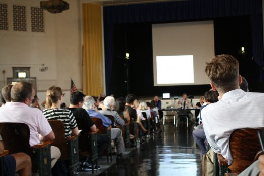 Community Board 1 Chairman Christopher Olechowski addresses a crowd at Automative High School. (Photo: Natalie Rinn)