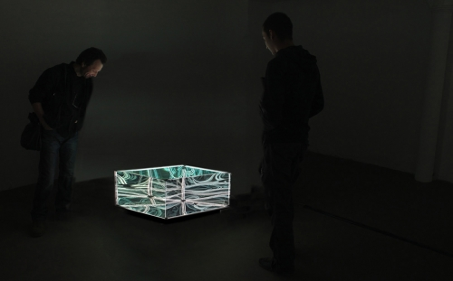 "Membrane Table by Numen / For Use. 2015, wood, glass, spy mirrors, light bulbs, steel 23.6"" x 23.6"" x 15.75"" (Muriel Guépin Gallery at Miami Project)"