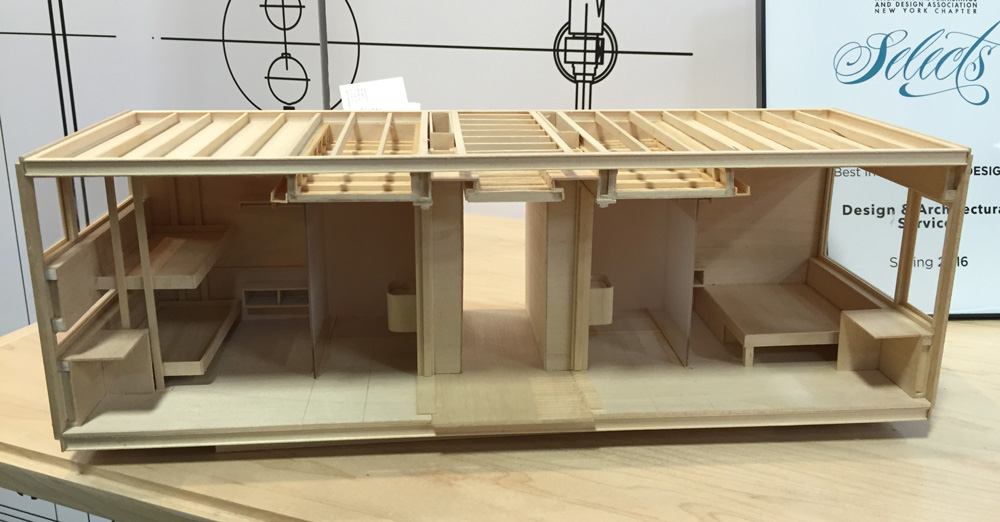 Model of one unit housing two separate rooms.