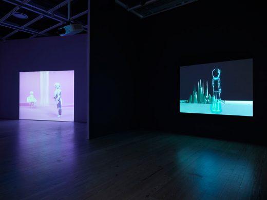 "Installation view of ""Dreamlands: Immersive Cinema and Art, 1905-2016"" (Whitney Museum of American Art, New York, October 28, 2016-February 5, 2017). Oskar Schlemmer, Das Triadische Ballett [Triadic Ballet], (1922/1970) E.2016.0044; Pierre Huyghe, One Million Kingdoms, (2001) E.2016.0050. Photography by Ronald Amstutz."