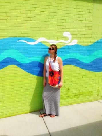 Amy Lyon Smith in front of an art wall in Carolina Beach, North Carolina