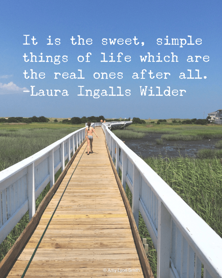 "Laura Ingalls Wilder Quote ""It is the sweet, simple things of life which are the real ones after all."" Background - boardwalk through a salt marsh in Carolina Beach, North Carolina"
