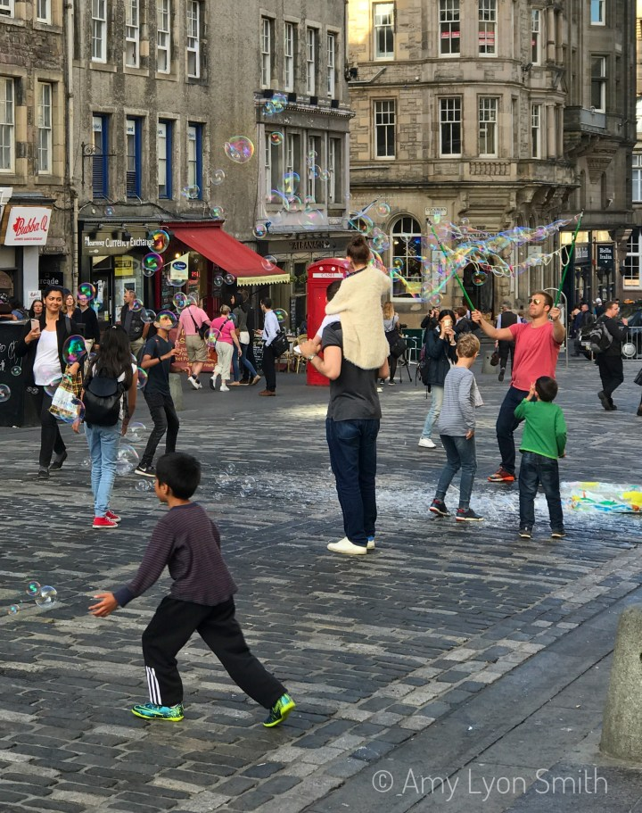 Bubble blowing on the Royal Mile in Edinburgh Scotland