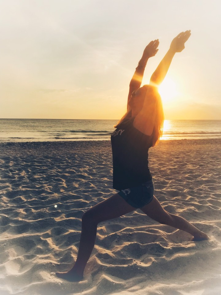 Amy check-in with Yoga Crescent Pose for Yoga Challenge on the beach at sunset in Naples, Florida