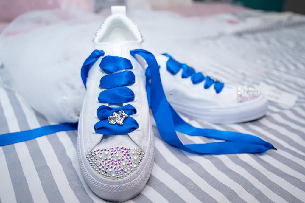wedding day shoes with blue ribbon shoe laces