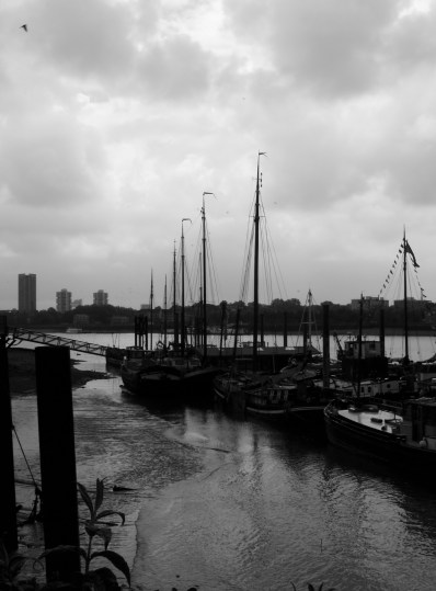 Sailing barges moored on the Thames
