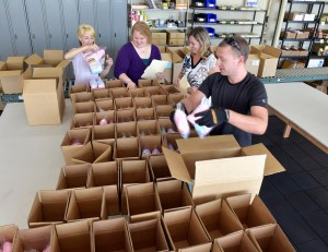 Photo of Beech Tree Trading employees packing boxes with products
