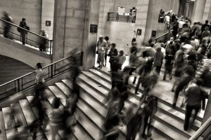 Blurred image of people walking on stairs