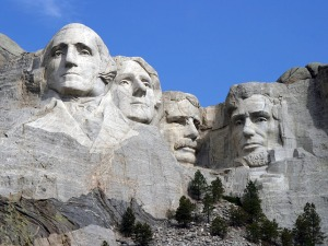 Sculptor Gutzon Borglum began drilling into the 6,200-foot Mount Rushmore in 1927.