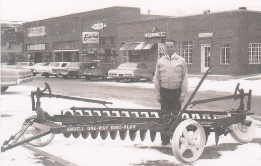 My grandpa, Francis Angell, with the plow his dad invented on the widest main street in America, Plains, KS