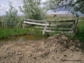 building livestock fences of water ditches creeks