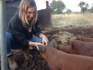 The first time she fed a pig. Her Grandparents used to own a large farm in the area. This is her heritage.