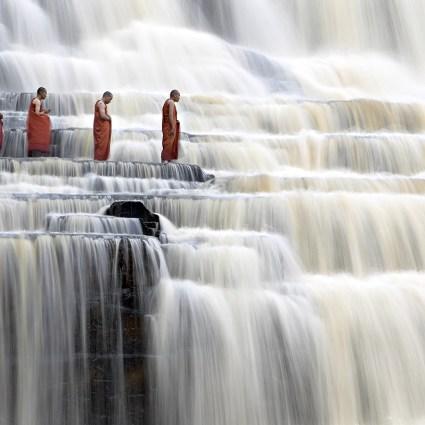 Monks in waterfall – Dang Ngo