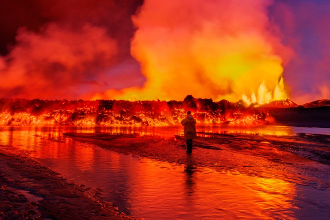 Woman watching the lava flow at the Holuhraun Fissure eruption near Bardarbunga Volcano, Iceland