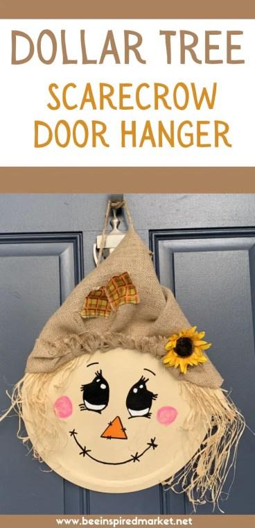 DIY Dollar Tree Scarecrow door hanger made and hanging on front door