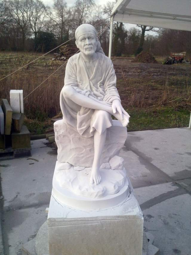 marble Shirdi Sai Baba statue-carving finished. Sculptor in stone and bronze