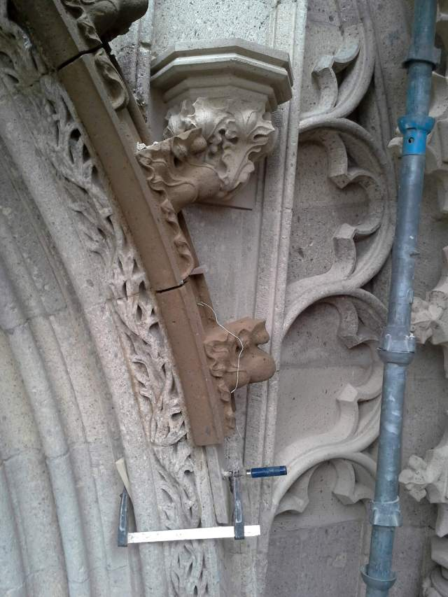new kanthogels hang on the outside of the nose cone. South Portal,  St. Stephen's Church in Nijmegen