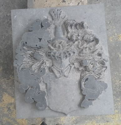 coat of arms in bluestone: 3-precarving mantling
