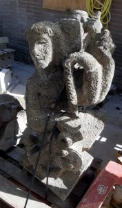 The old flying buttress statue The Hope made of tuff stone