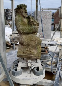 old flying buttress sculpture on pre-sawing machine