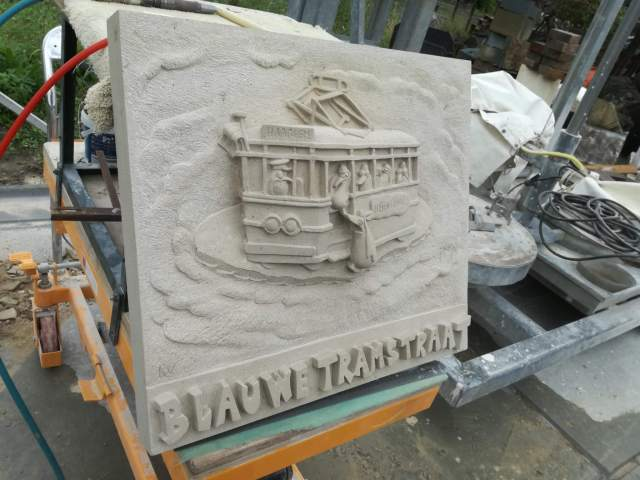 House sign Blue Tram Street carved in sandstone