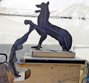 Making steel frames for the work of griffin in clay and then casting in plaster