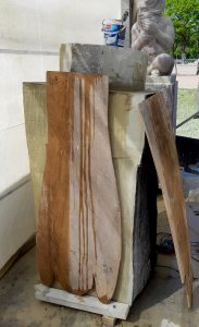 the block of stone is cut in half with the chainsaw and glued. The plywood contour templates are there for the sizes