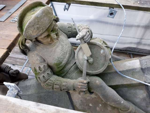 repairing the drumstick of the Little Drummer Boy on the flying buttresses of St. John's Cathedral in Den Bosch