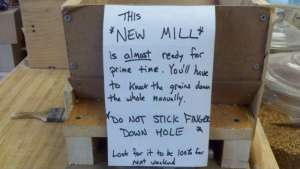 new mill with sign