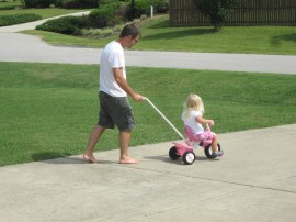 Learning to ride her new tricycle