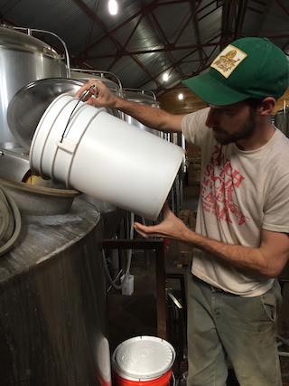 Head Brewer Garrett Crowell Adding Wildflower Tea to Whirlpool