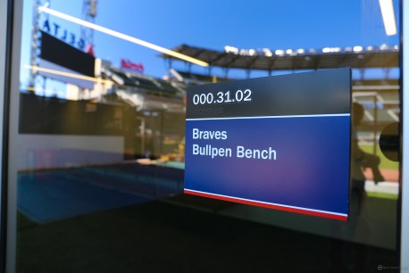Braves Bullpen Bench, with a view of the stadium in the reflection.