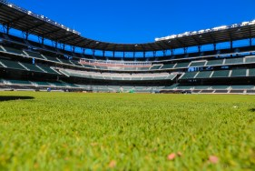 A view from the grass in the outfield, facing home plate.