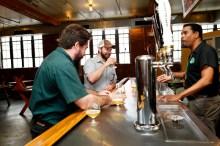 Brooklyn founder Garret Oliver does some bar tending