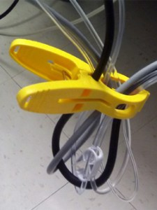 beesafe clip holding yellow hospital cords and lines securely
