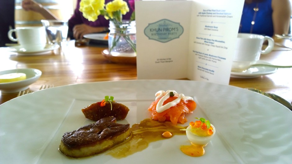 Duo of pan fried foie gras with apple chutney and smoked salmon with traditional garnish and horseradish cream.