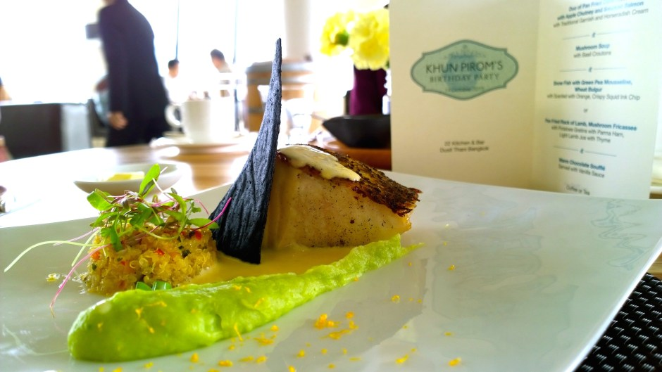 Snow fish with green pea mousseline, wheat bulgur, with orange zest and crispy squid ink chip.